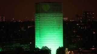 Grenfell Tower lit green a year after fire -   14 June 2018              Related Topics  Grenfell Tower fire                  Image copyright                  PA  A year after the fire that killed 72 people Grenfell Tower has been illuminated to mark the first anniversary of the disaster.  Twelve other buildings across west London and Downing Street were illuminated at 00:54 BST the time a fire was reported in a flat last June.  A vigil took place at a church near the block where the victims'