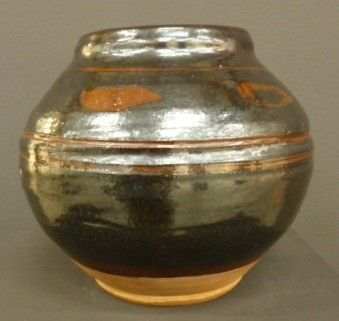 David Leach, stoneware vase of ovoid shape, tenmoku glaze decorated with a leaf pattern to the shoulder above two incised concentric bands. Impressed mark,. Height 18 cm