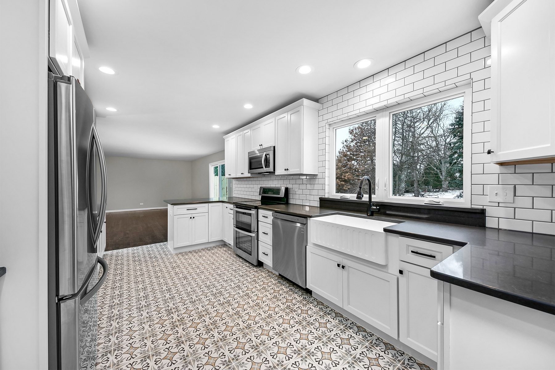 Kitchen White Cabinets With Gray Mist Quartz Counter Tops And Decorative Floor Tile Decorative Floor Tile Kitchen White Kitchen Cabinets