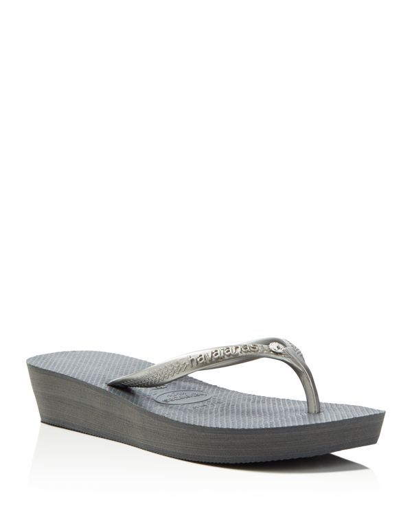 4e92881628b4 havaianas steps up the essential flip flop with modest wedge platforms and  inset Swarovski crystal details along the straps.