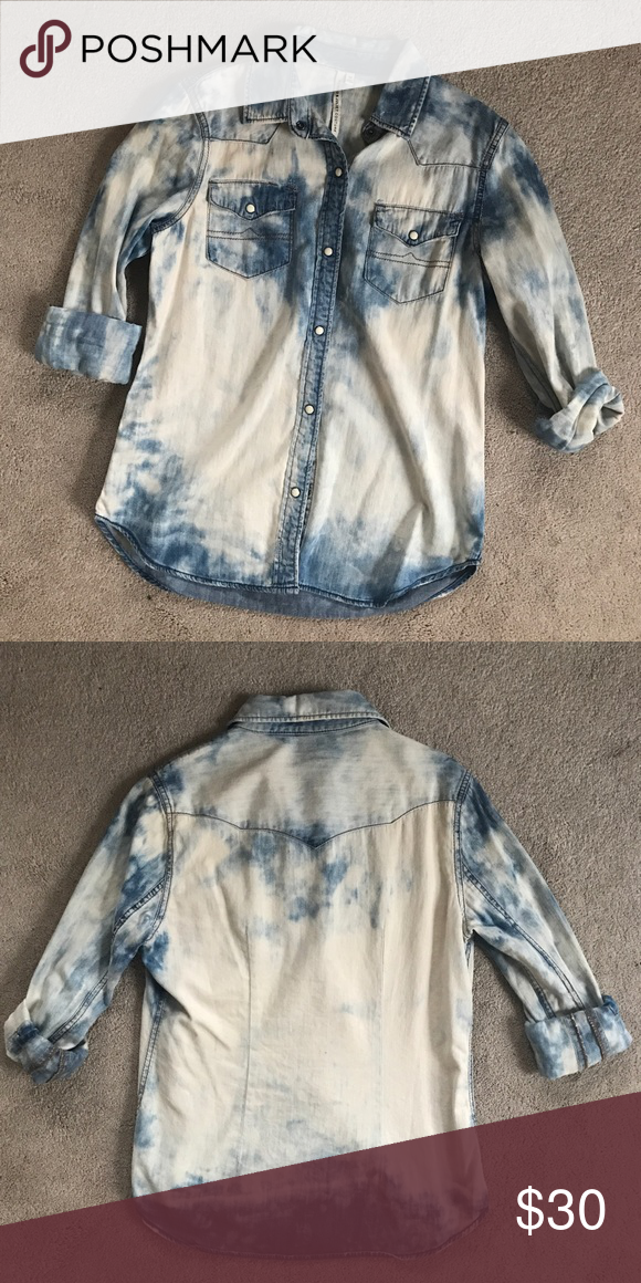 Romeo & Juliet Bleached Denim Button Up Top Super rad Romeo & Juliet Couture bleached out denim top featuring pearl snap buttons. Great condition. Revolve Clothing, Planet Blue, Free People, Urban Outfitters, Dolls Kill, Nasty Gal, ASOS, Nordstrom, Zara. Romeo & Juliet Couture Tops Button Down Shirts
