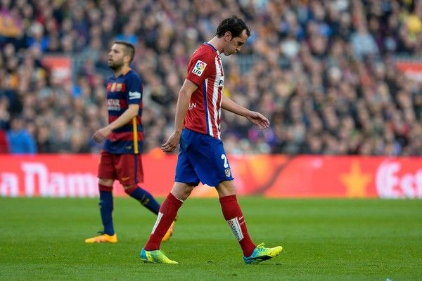 Atletico Madrid's Uruguayan defender Diego Godin leaves the pitch after being sent off by referee during the Spanish league football match FC Barcelona vs Club Atletico de Madrid at the Camp Nou stadium in Barcelona on January 30, 2016. Barcelona won 2-1.