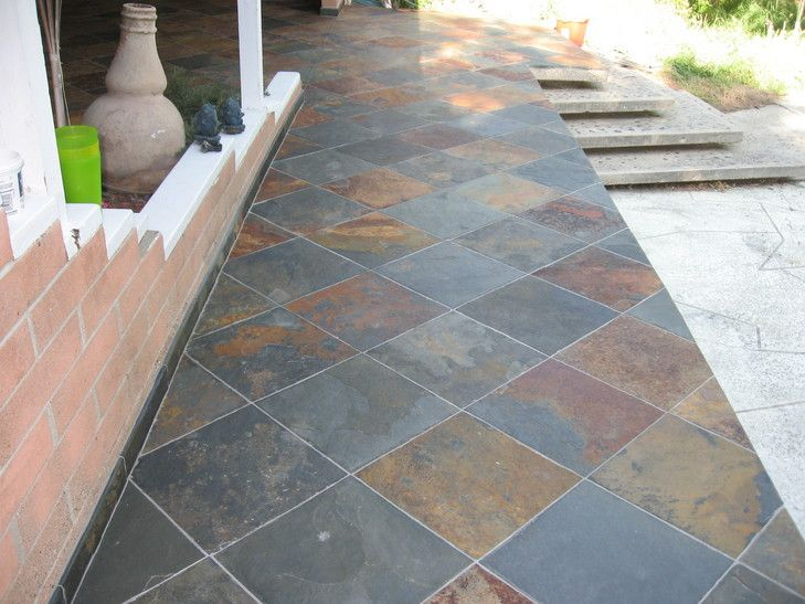 installation of slate tile for backyard patio photo - Concrete Tile Garden Decor