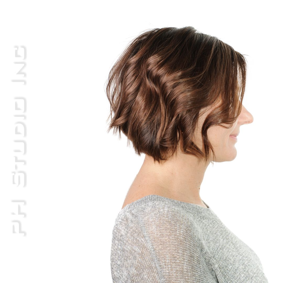 A dimensional, brunette with copper shade complements lob layered haircut.  Haircut/Style & Color: Kristina Puckorius  Products: Aquage Uplifting Foam, Beyond Body Sealing Spray & Aquage Transforming Paste Lite.