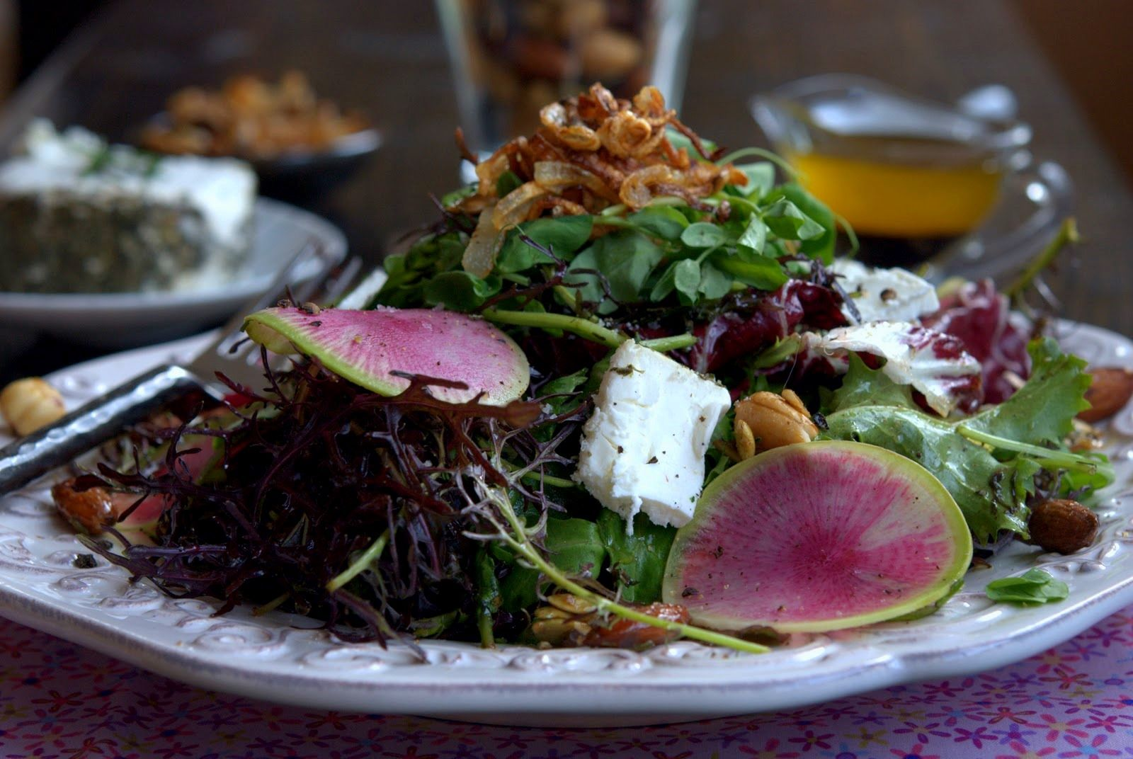 Mixed Greens Salad with Watermelon Radish, Crispy Shallots, and Sweet and Spicy Rosemary Nuts