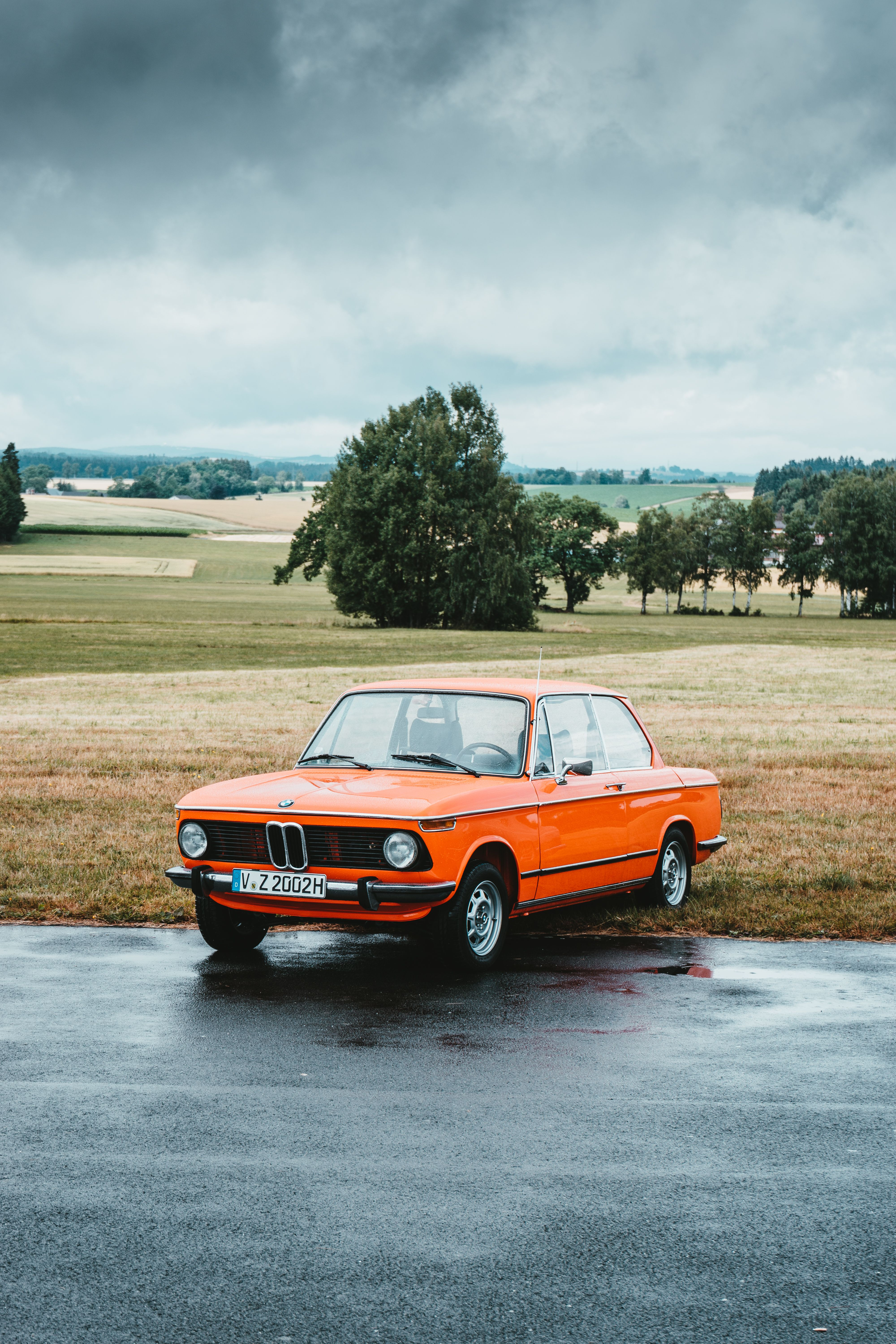 11 Dreadful Vintage Pictures Orange Classic BMW Coupe Parked At Roadside Under G…