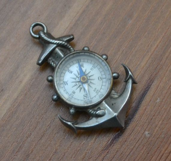 This beautiful watch fob is silver tone base metal and features a working compass. The compass is functional and the needle spins freely but I would not recommend attempting to navigate with it... Condition is excellent and it is almost 1.5 long.  Item is sold as-is.  We welcome haggling in this shop