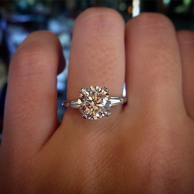 Round Brilliant Engagement Ring With Tapered Baguettes Diamondsengageme Round Halo Engagement Rings Brilliant Engagement Rings Round Brilliant Engagement Ring