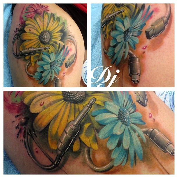 My Electric Daisy tattoo done by DJ at Bad Apple Tattoo in ...
