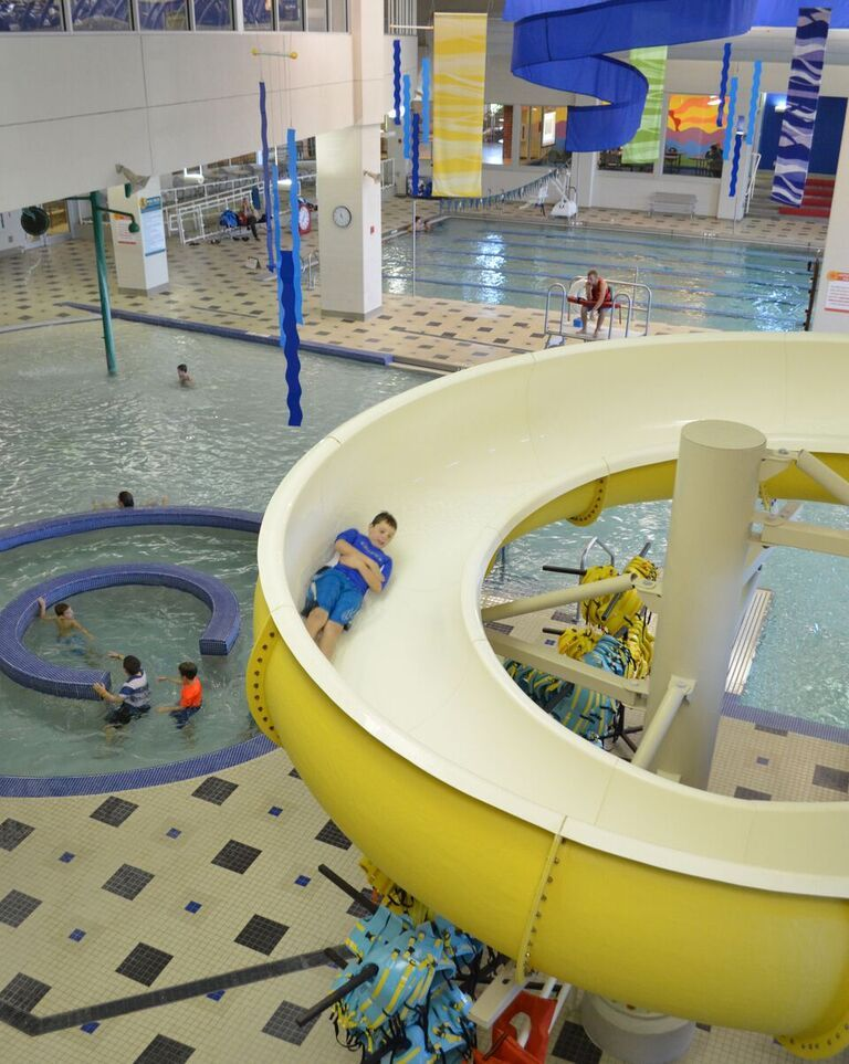 Indoor water slides and pools monon community center carmel in all about us carmel for Local swimming pools with slides