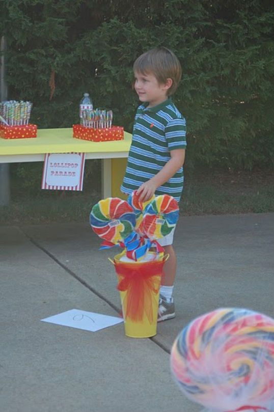 """GAME: """"The Lollipop Parade was another popular place!  We played circus music and then stopped the music and called out a number.  The child on the lucky number could go get a lollipop.  This was so popular that we doubled up the children for this game and had 2 at each number."""""""
