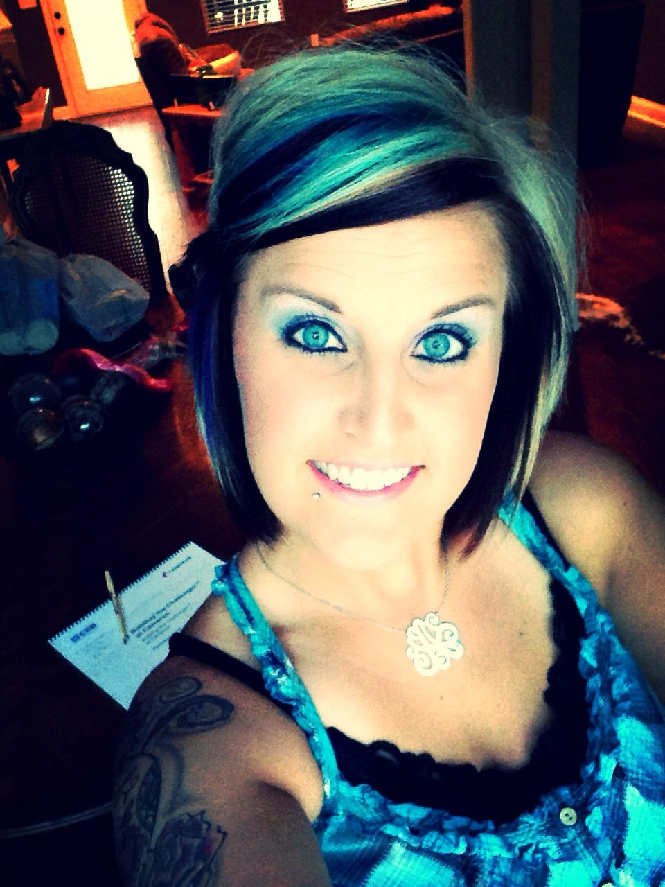 Turquoise chunk with blonde and dark brown hair color