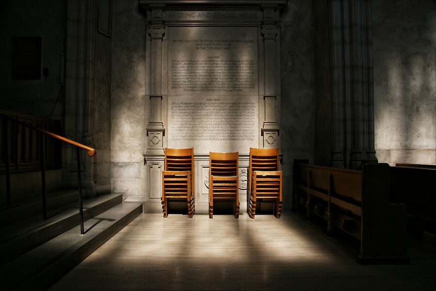 The stacked chairs inside Trinity Chapel at the University of Toronto