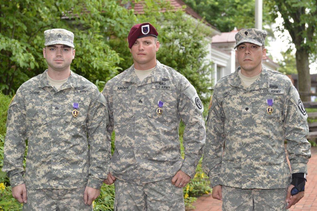 Sgts. Cory Doane, Sean Karpf, and Spc. Arael Lopez