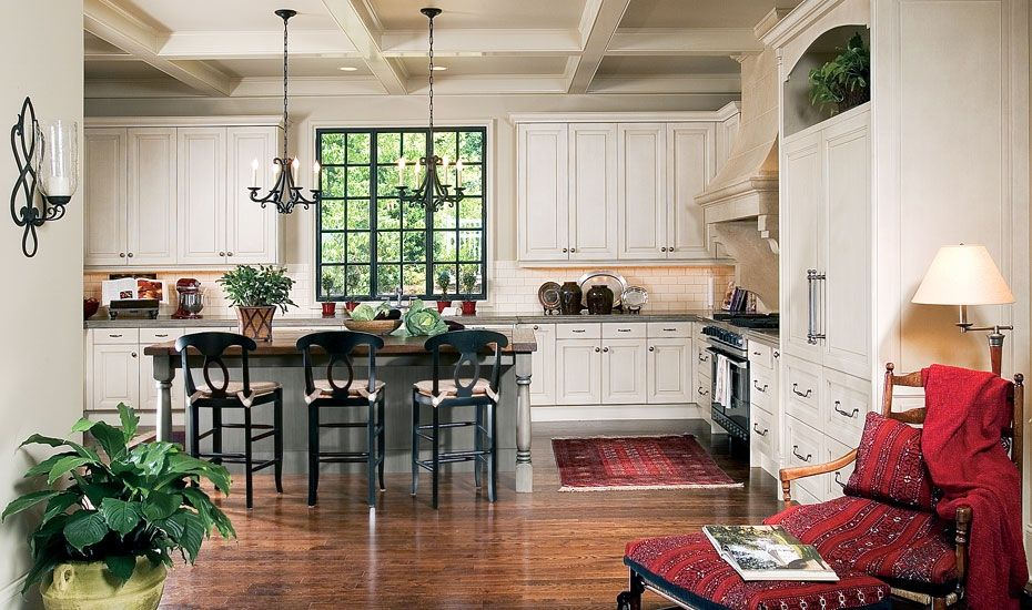 In this white kitchen, the dark window frame draws your