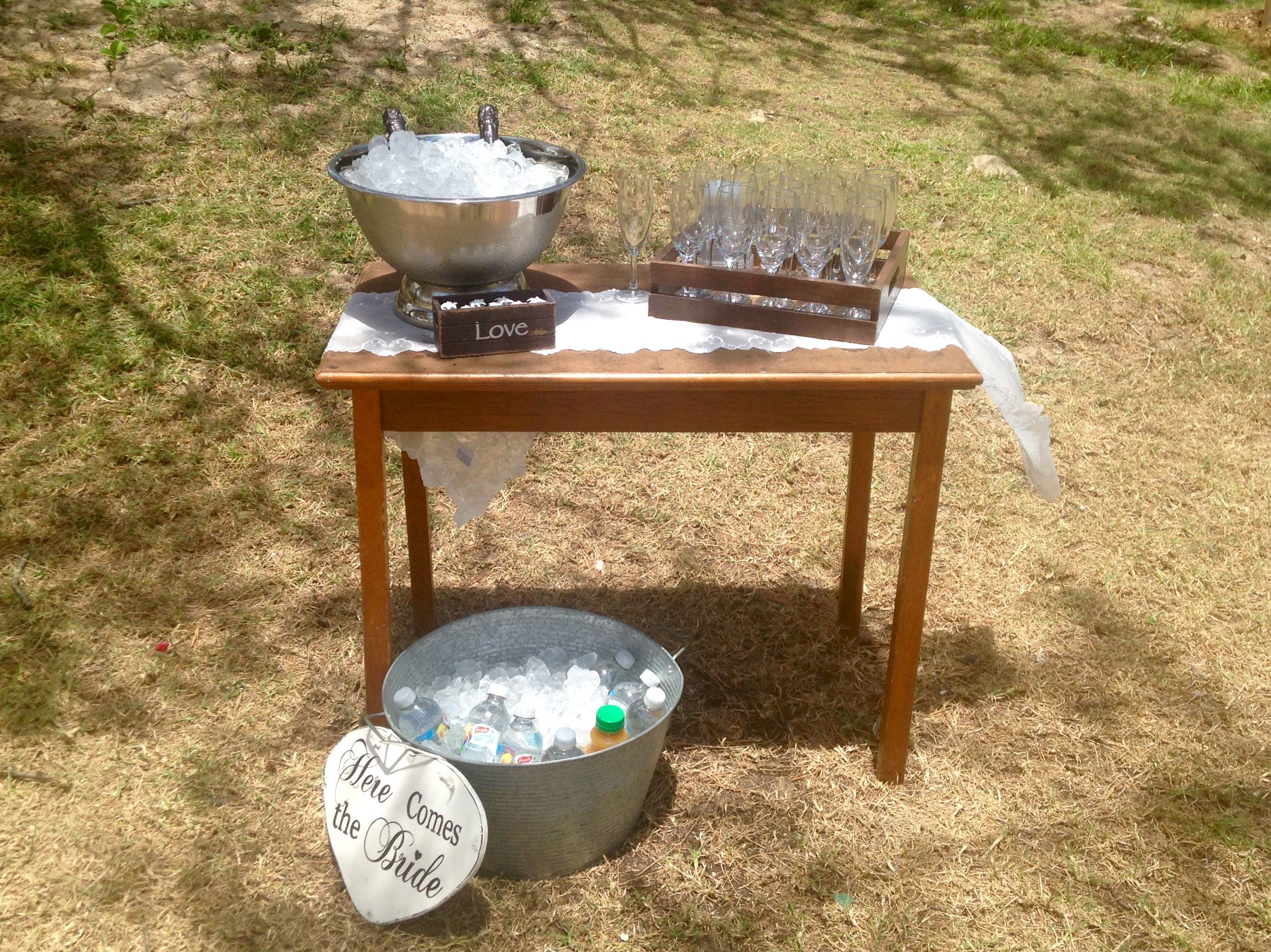 Beach wedding ceremony drinks station