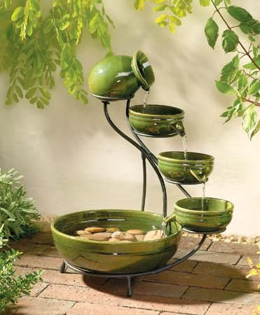 Superbe Featuring A Glazed Green Ceramic Four Tier Cascading Solar Powered Water  Fountains. Solar Panel Has