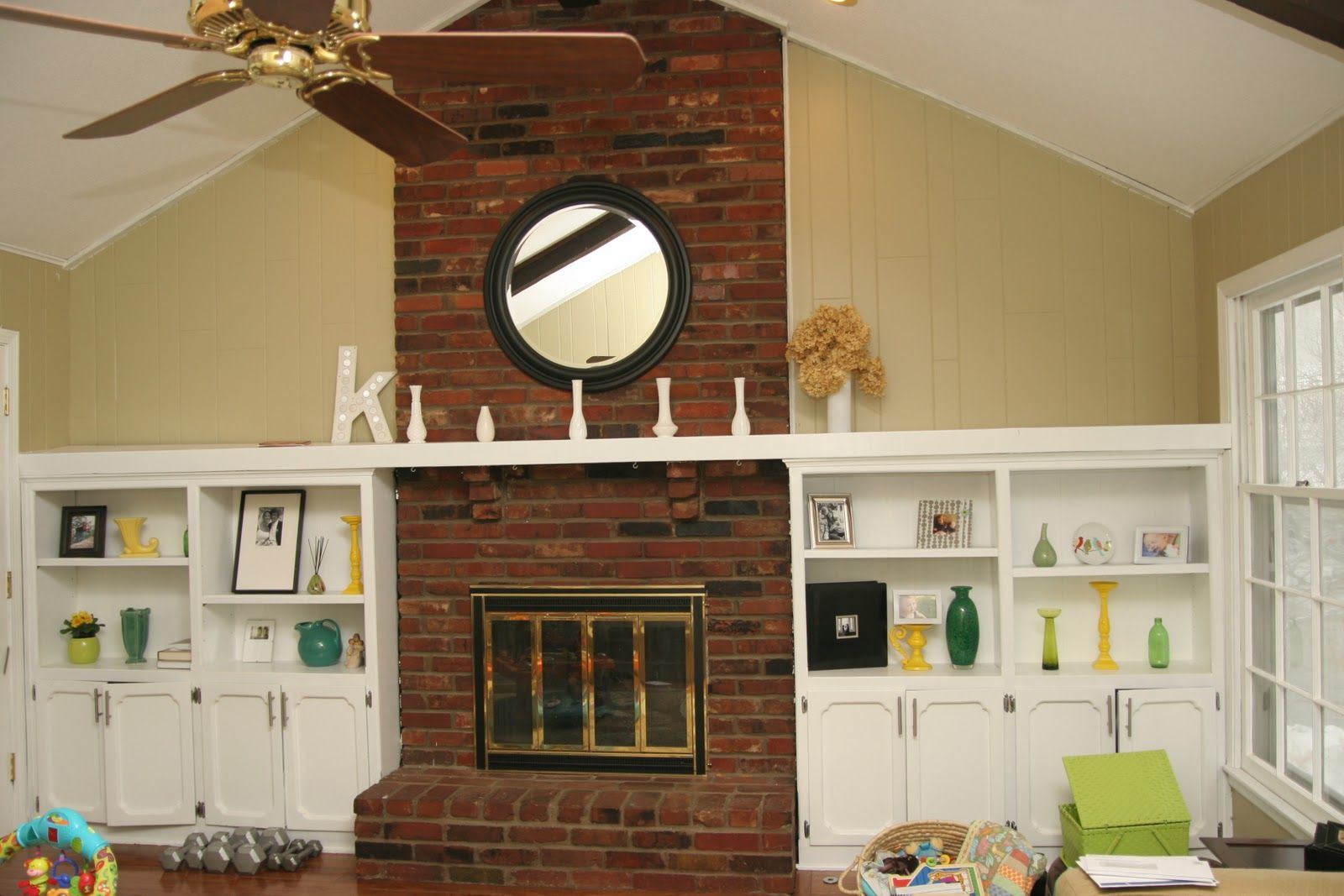 just a can of white paint | mantle, brick fireplace and room
