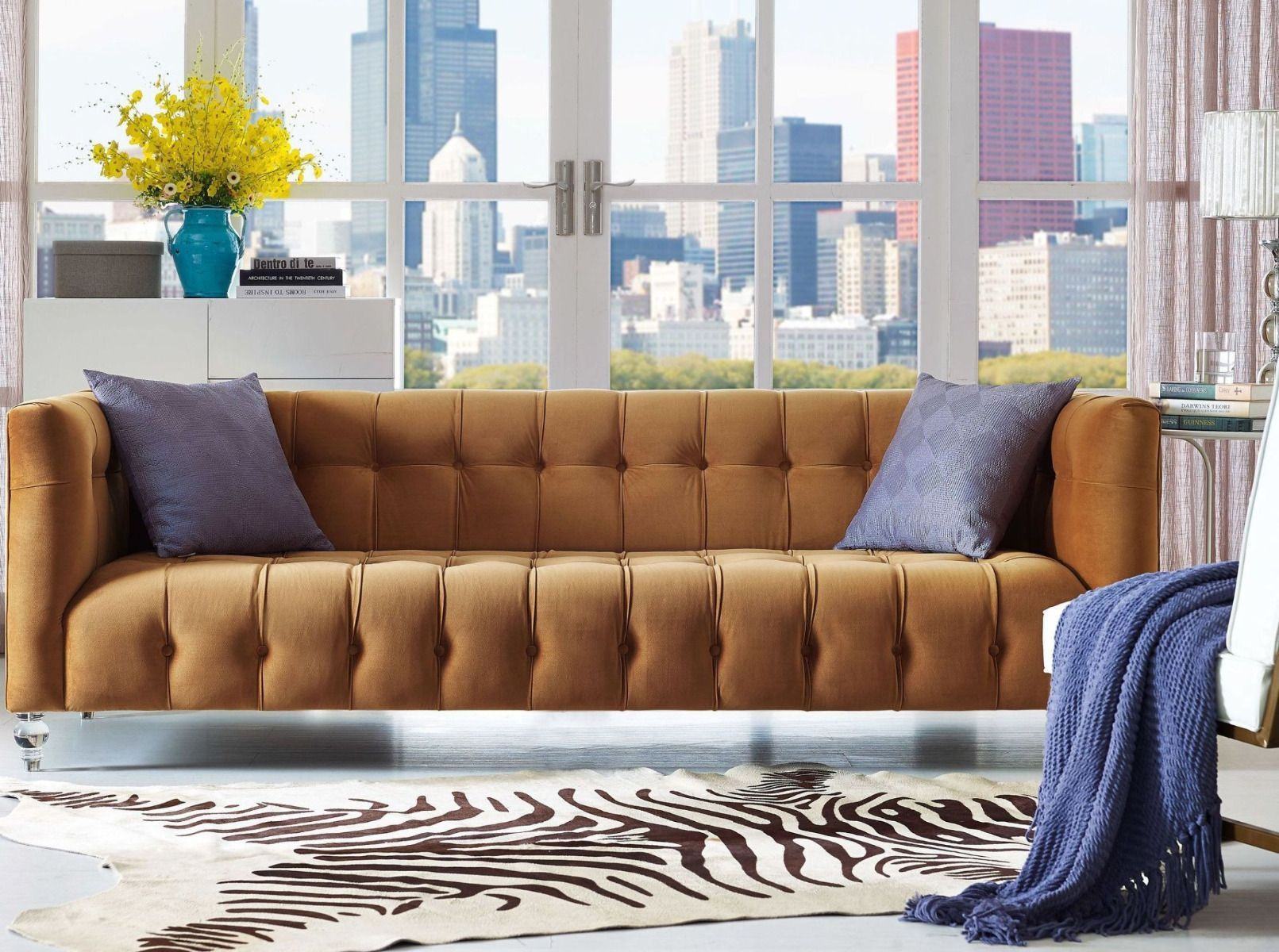 This rich velvet upholstered sofa is designed with a deep seat