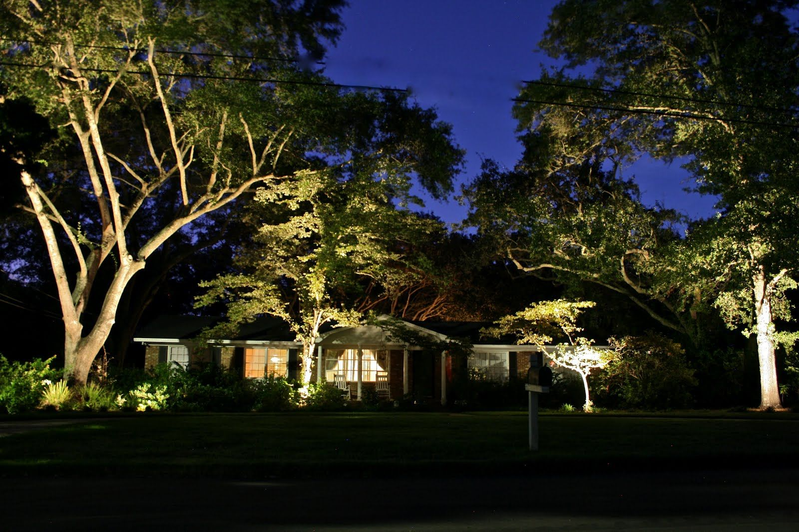 Landscape Landscape Lighting Behind The House At Night With Low Voltage LED Lights Are Very Bright Looks Incredibly Beautifying Among Trees from Landscape ... & landscape lighting -WOW factor. Turn your front yard into the envy ... azcodes.com