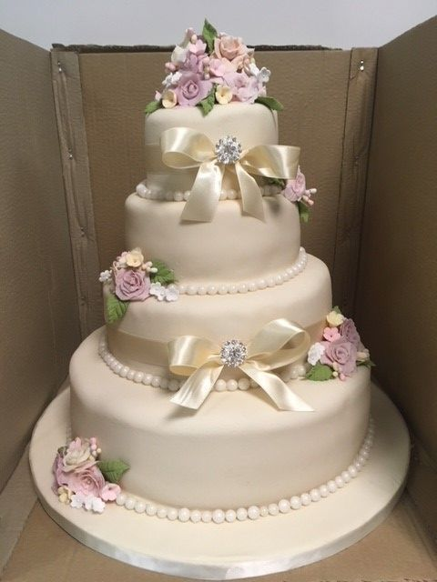 Beautiful Wedding Cake Ready To Go Out On To The Cake Table