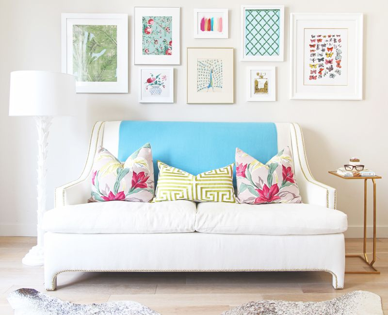 Picture arrangement over sofa...some white, some gold frames ...