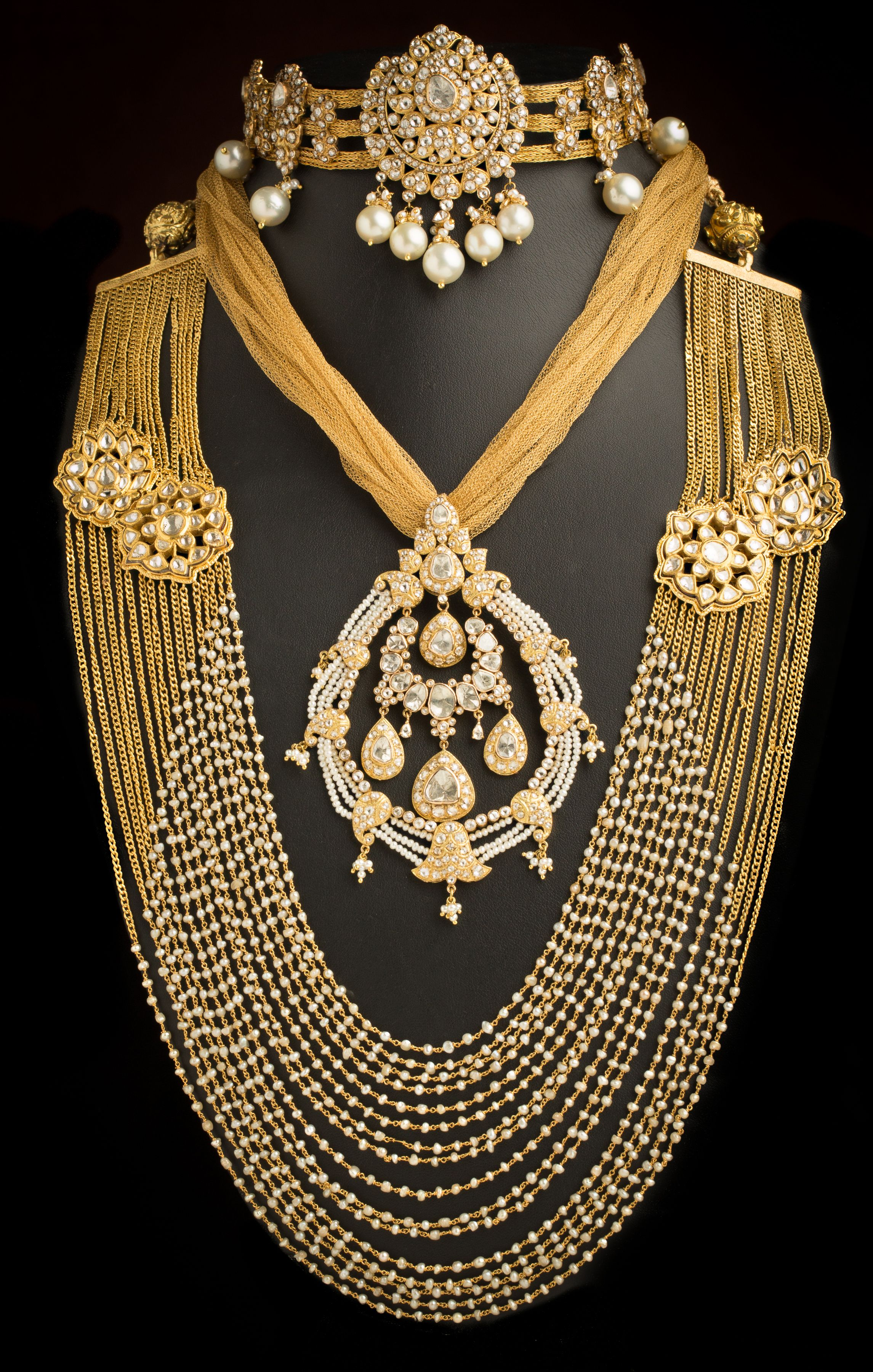 Melange of polkis diamonds gold and pearlsindian bridal jewellery