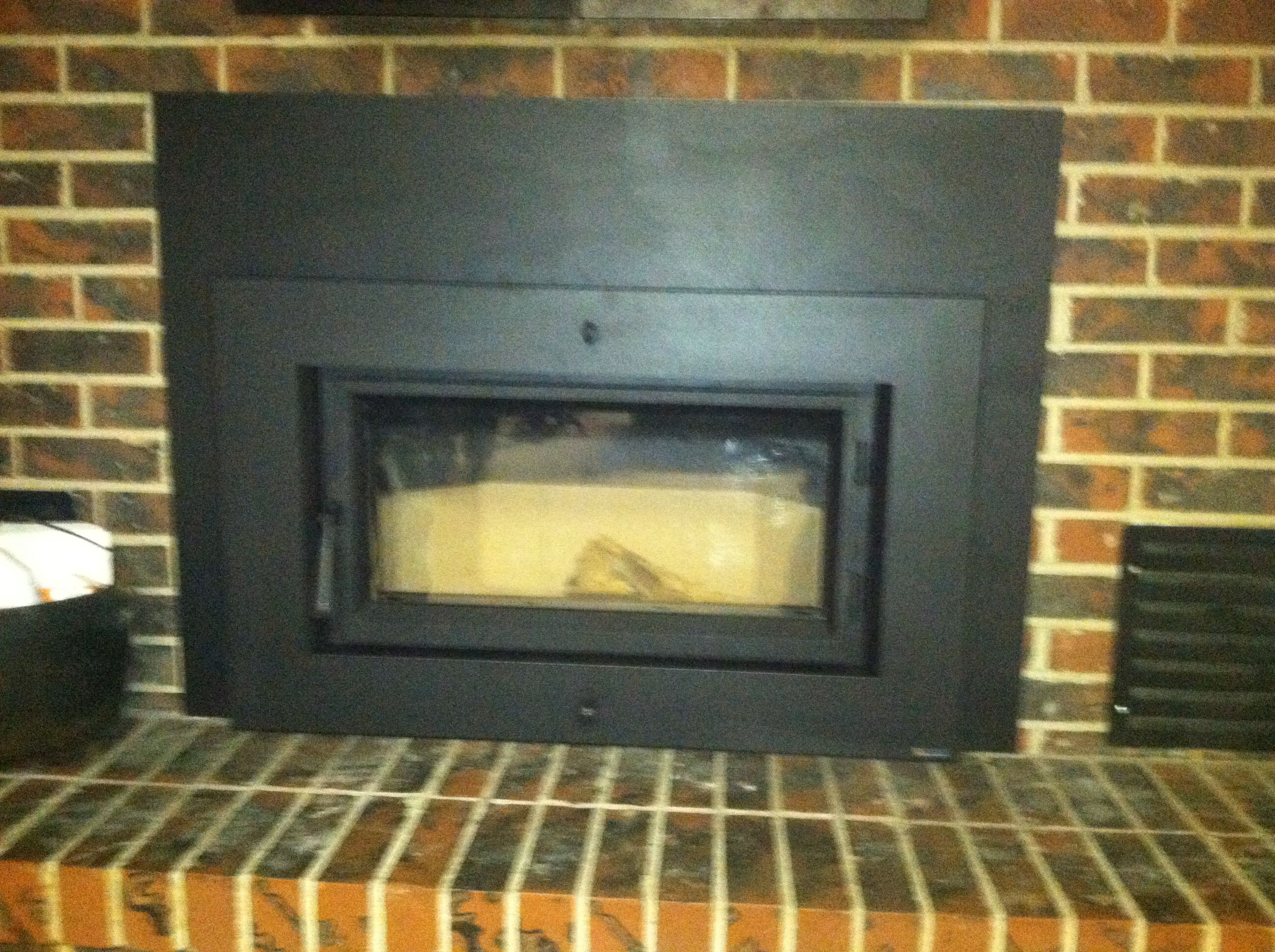 rectangular wood insert by fireplacxtrodinair chimney and stone