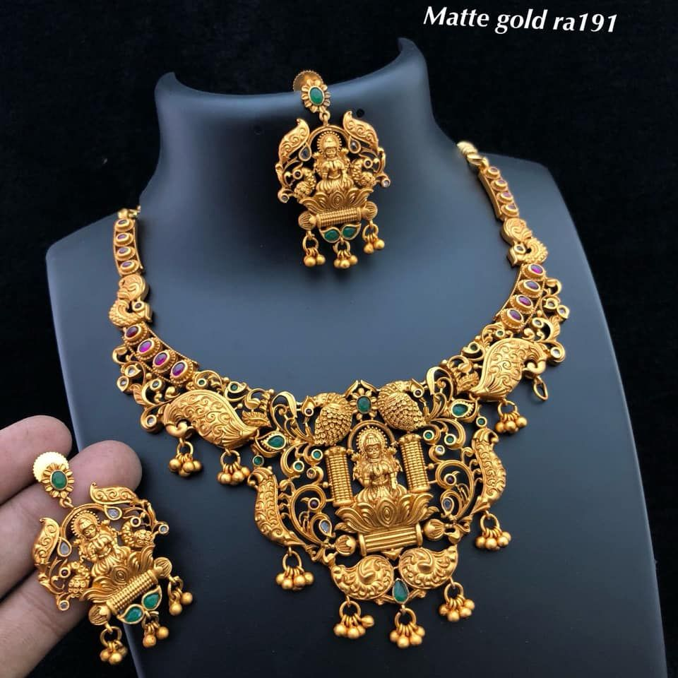 0d5d65617 Beautiful matte gold covering necklace with large lakshmi devi pendant.  Necklace studded with multi color stones. Necklace woth muvvalu hangings .