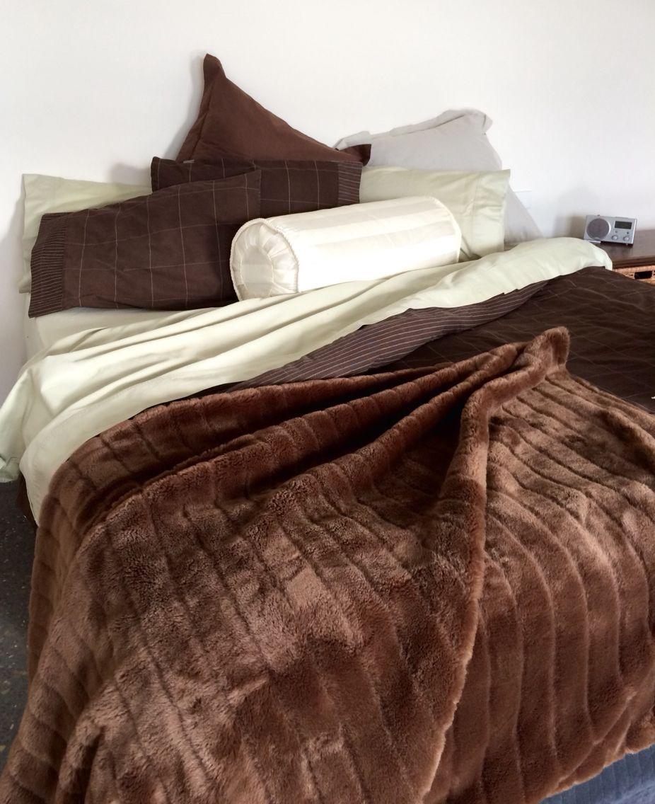 Le cache bolster cushion in classique creme it hides a queen sized