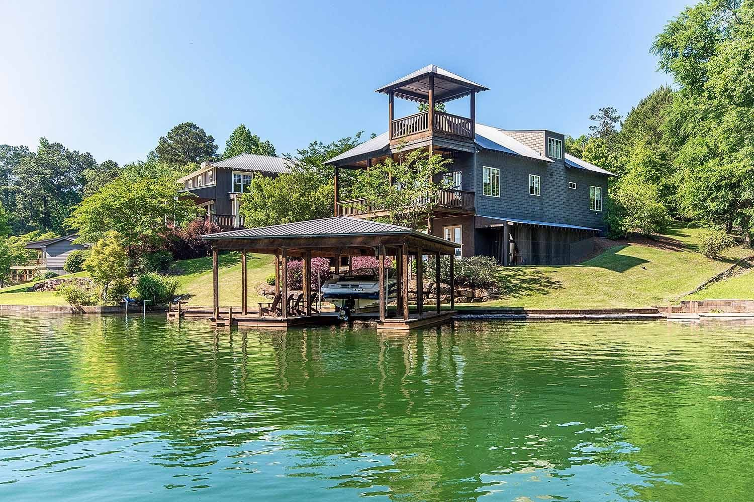 CLICK2TOUR 344 Blocker Rd off Parker Creek on Lake Martin. Charming 4BR/4.5BA Craftsman w/ 2 living areas, 20' ceiling in main living areas, stone fireplace, mulitple covered porches + tower. boathouse w/lift, pier, deck, beautifully landscaped and much more! For more details, call/text Amanda Scroggins, (256)749-6634, RE/MAX Around the Lake. Photos & tour by Sherry Watkins…I Shoot Houses…http://www.Go2REassistant.com/VirtualTours.htm