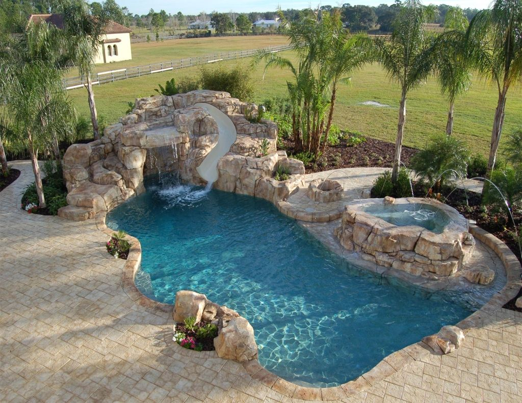 pool slide hot tub on the side water fall and shooter things out of the side of hot tub - House Pools With Slides