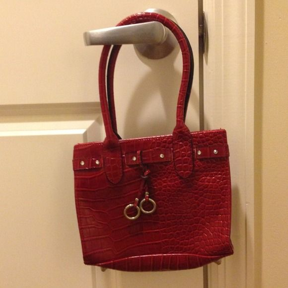 Red croc purse Red faux croc purse, pocket inside, black lining, crystals on front trim, can be used as a purse or small tote bag. Bags