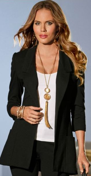 I dont like this necklace, but i love the look of a blazer/long necklace combo.