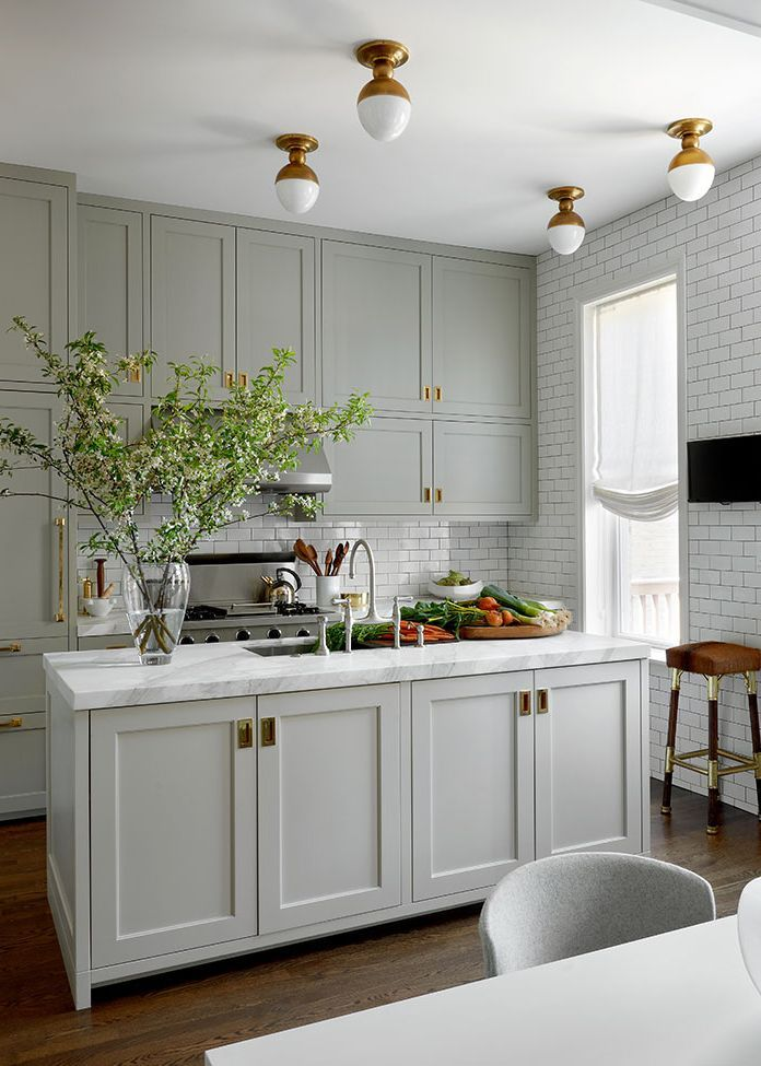 A Classic Grey Kitchen With Beautiful Brass Accents And Flush Mount - Light grey green kitchen cabinets