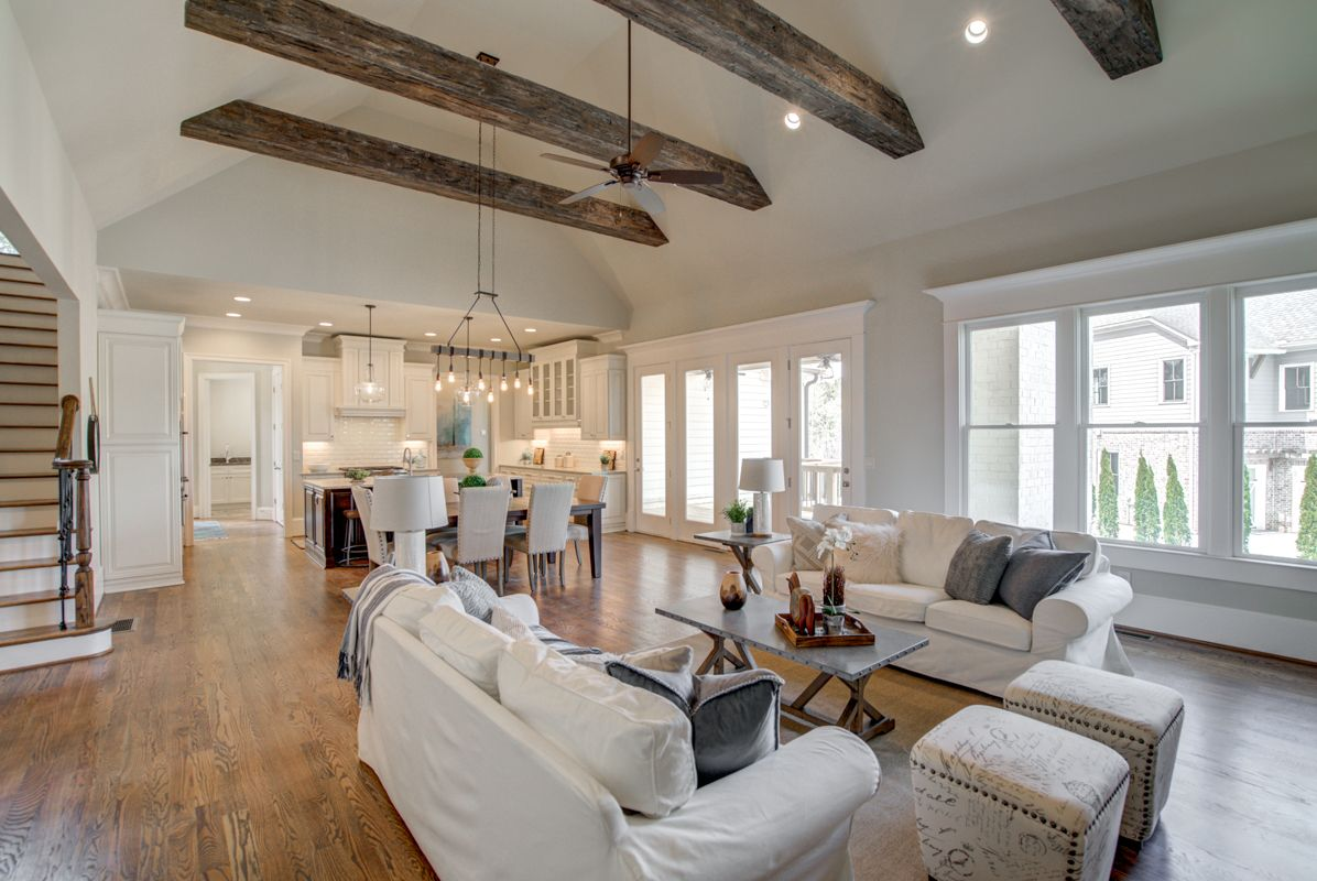 Great Room Features Vaulted Ceiling With Stained Solid