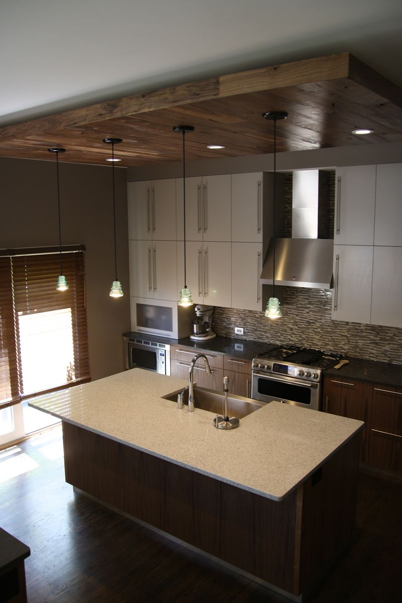 Wood ceiling accents is a nice natural element in this ...