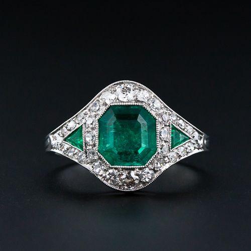 Art Deco Emerald Diamond Ring with 1.10 carat center emerald and 2 triangular emeralds, tcw of .20 carats. 30 round cut diamonds, VS-SI/H-I tcw of 0.50 carats. Platinum. Circa 1920s.