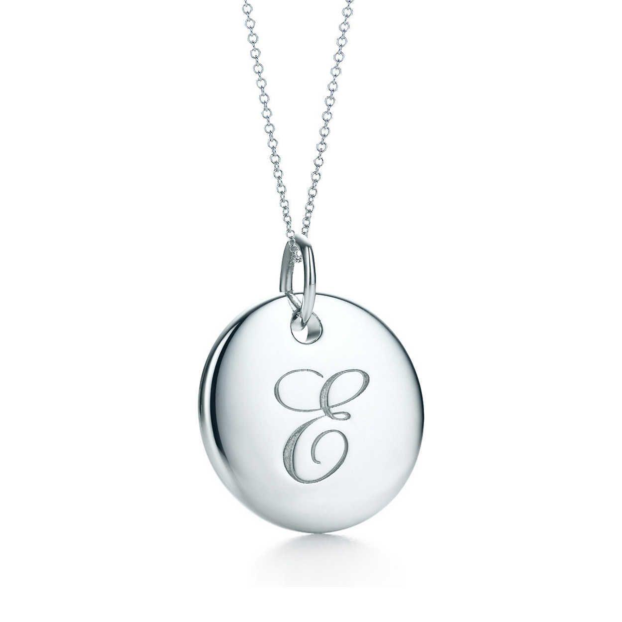 82b62510aed5 Tiffany Notes Alphabet disc charm pendant