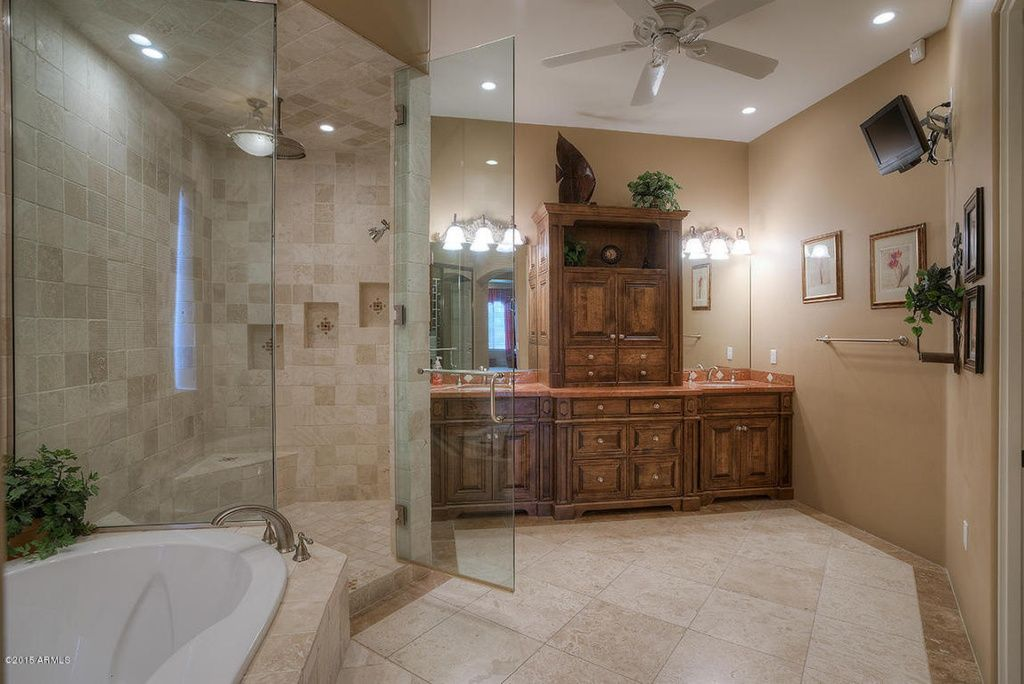 Traditional Master Bathroom With Simple Granite Counters Raised