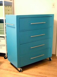 old dresser turned craft supply storage on wheels.  Looks very similar to my orange cabinet I need to paint.  Paint a softer shade of aqua for the studio and attach bar on side to store necklaces to repurpose.