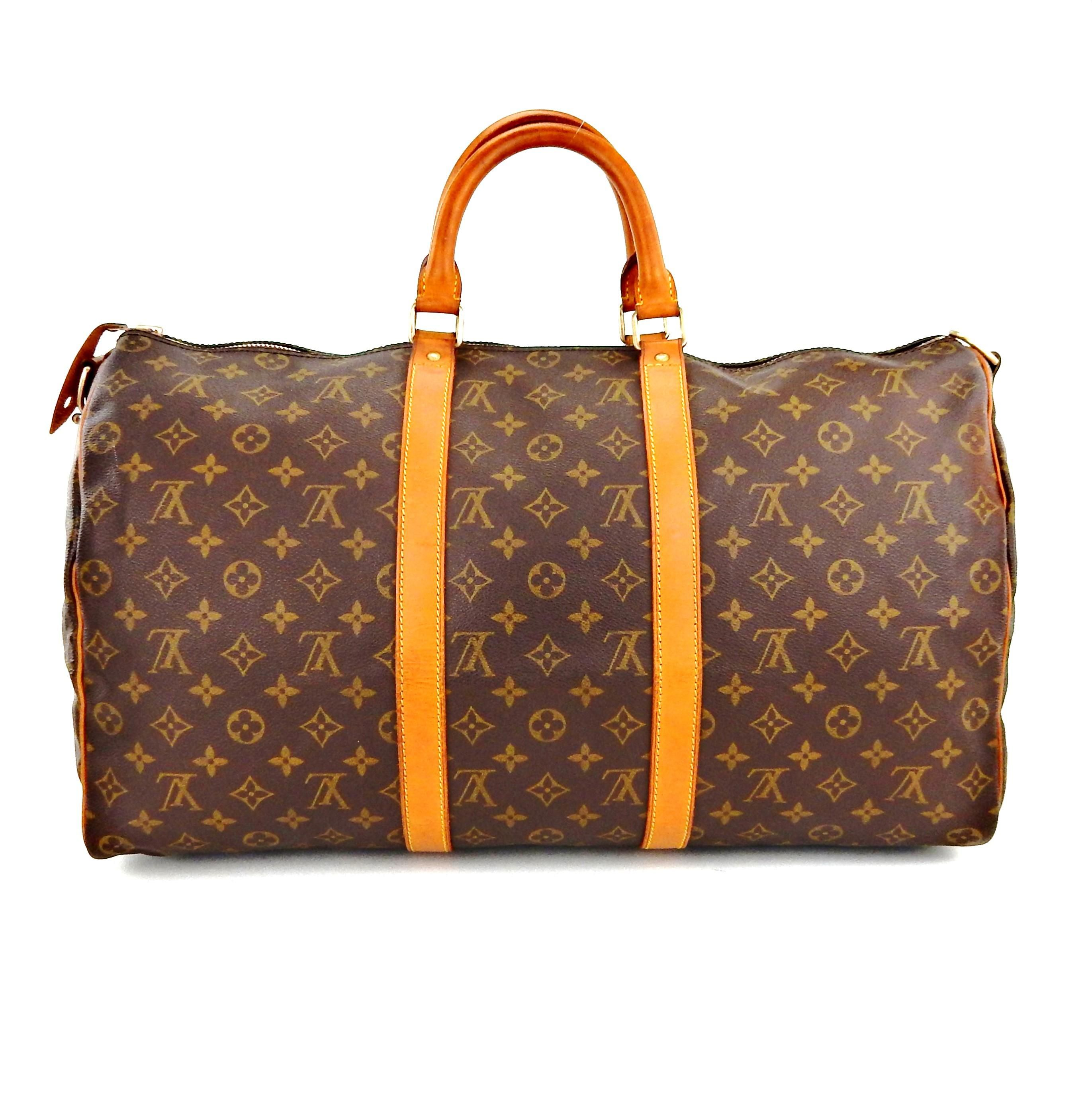 Louis Vuitton Keepall 50 Monogram Canvas Leather Boston Luggage Travel  Brown Travel Bag. Save big on the Louis Vuitton Keepall 50 Monogram Canvas  Leather ... fba8d5dbf712a