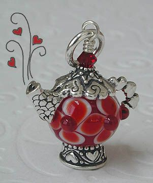 teapot. This is just about the most perfect pendant for me. Tea, which is a necessity of life. Silver, my metal of choice. Red, my favorite color. And beading. Perfect.