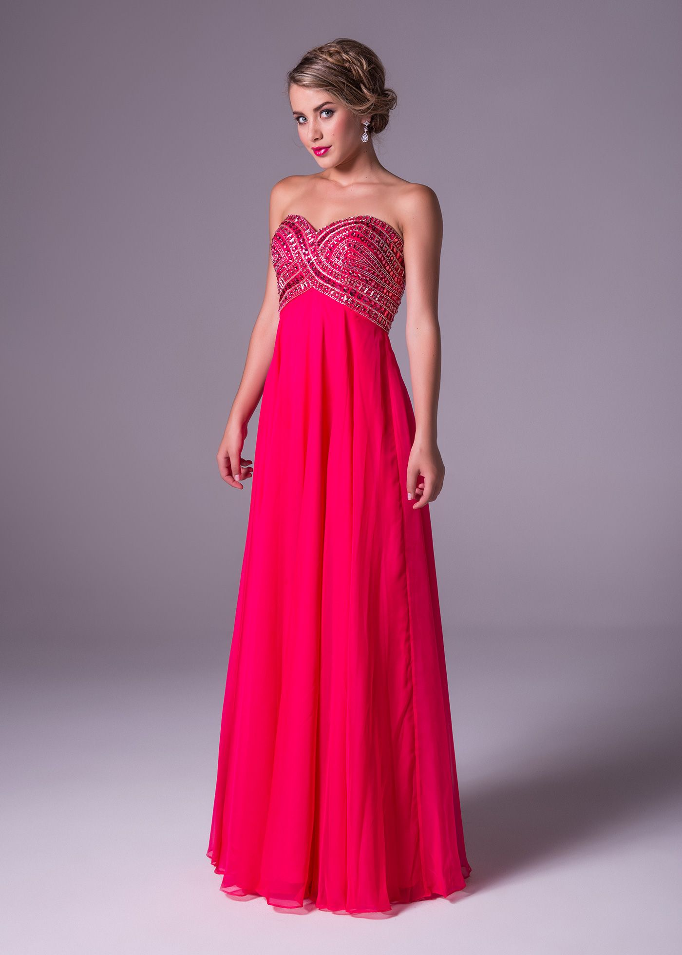 Cerise pink bridesmaid dress  This cerise pink gown will draw you in at the waist with it fully