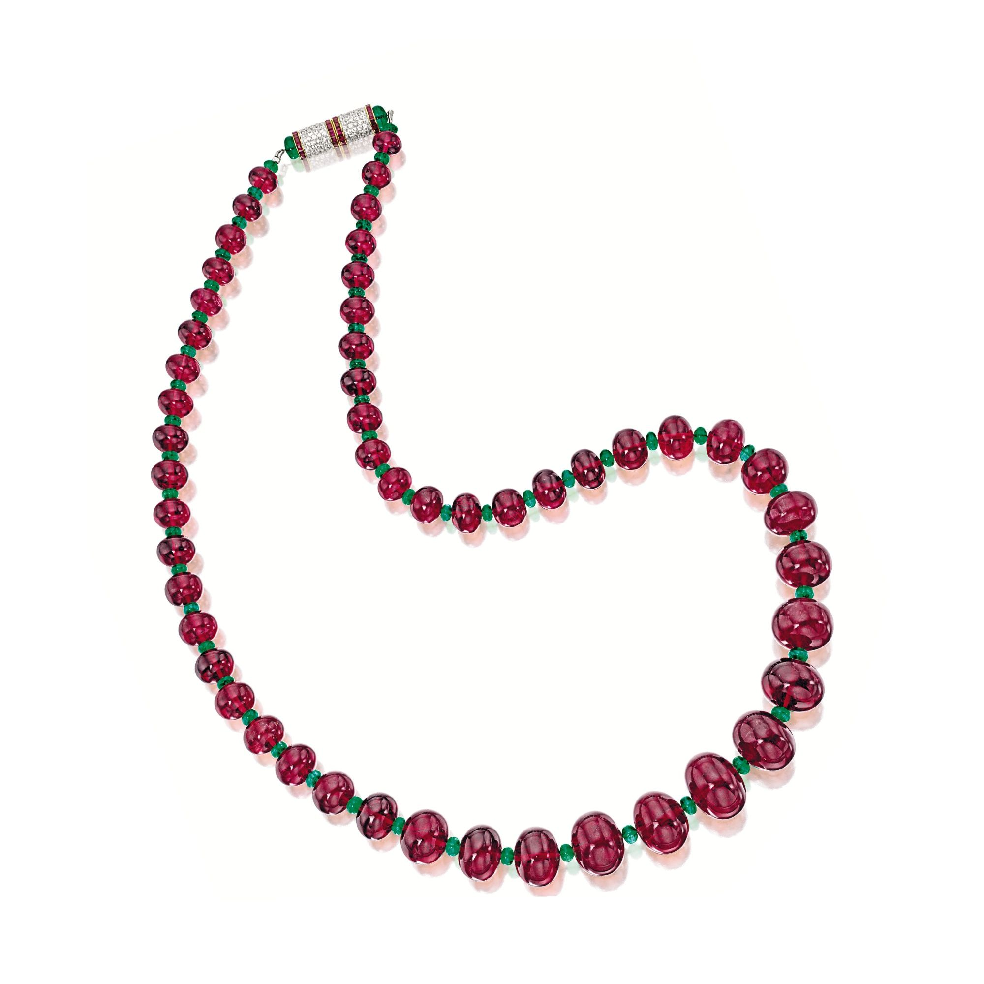 RUBELLITE, EMERALD AND GEM-SET NECKLACE The necklace composed of fifty-one graduated rubellite beads together weighing approximately 638.00 carats, spaced by emerald beads together weighing approximately 32.90 carats, completed by a cylindrical clasp set with rubies and colourless sapphires together weighing approximately 1.60 and 2.00 carats respectively, mounted in 18 karat white and yellow gold, length approximately 665mm.