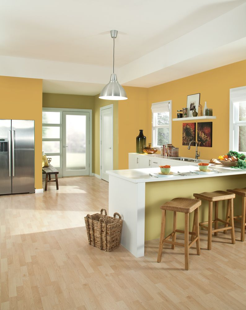 A kitchen dressed in sherwin williams yellow color of the for Sherwin williams yellow paint colors