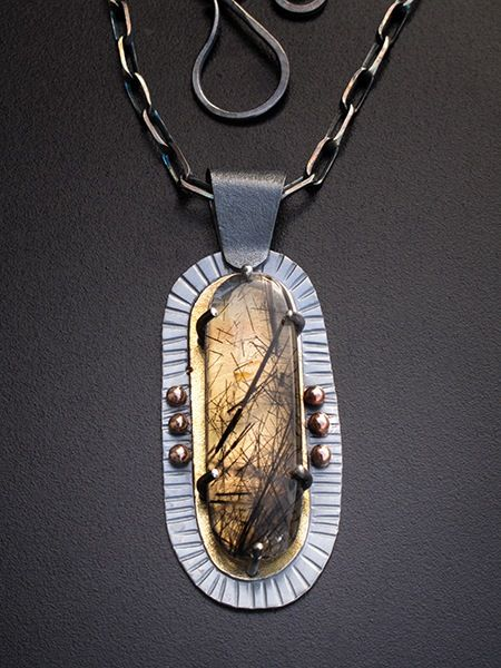 Image of tourmaline in quartz pendant