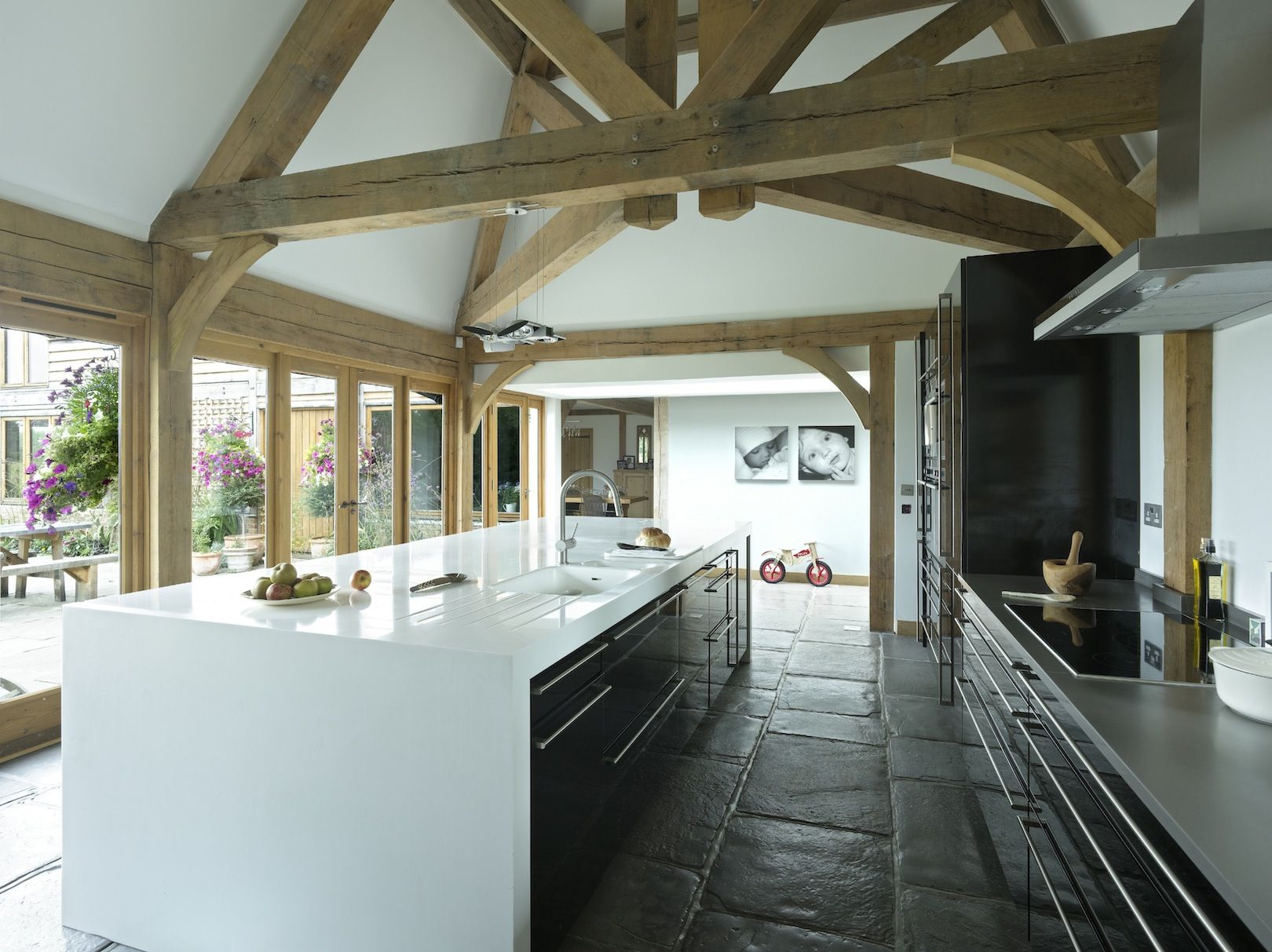 Border oak modern kitchen with statement oak framing in for Modern barn kitchen