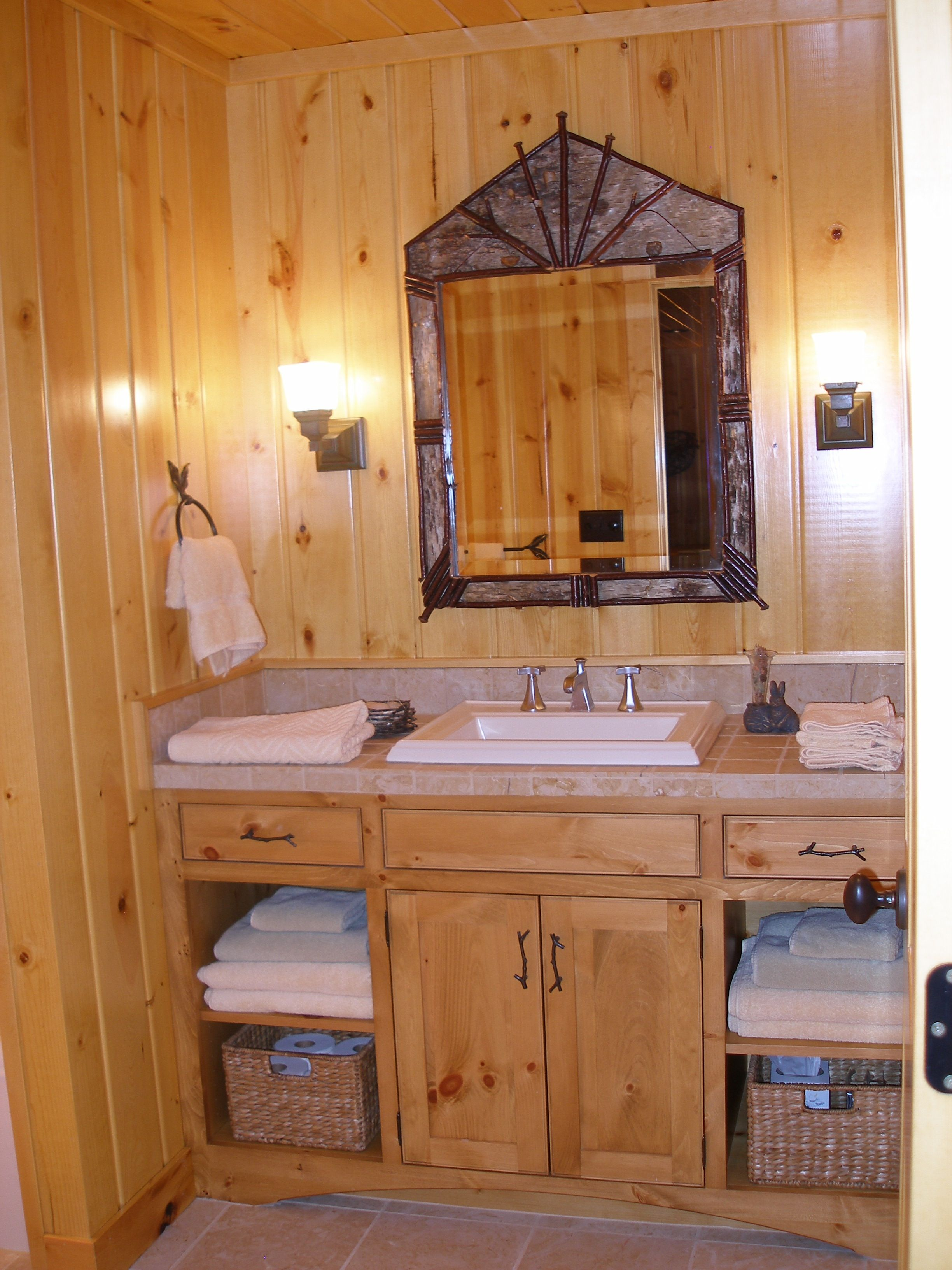 A lower level guest bathroom, in a log home in Phelps, WI. The