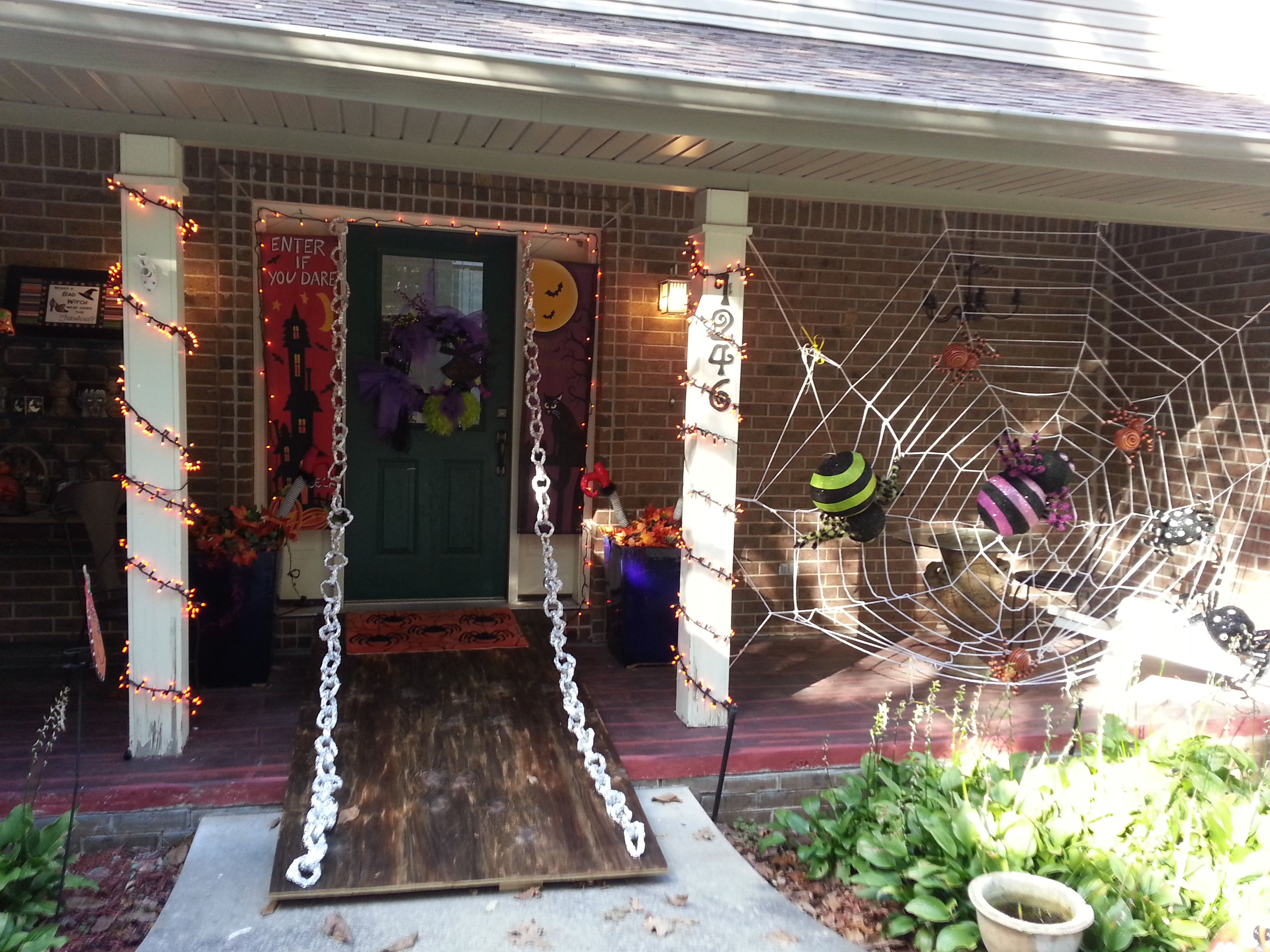 Halloween drawbridge using old piece of plywood and chains made from - front yard halloween decorations